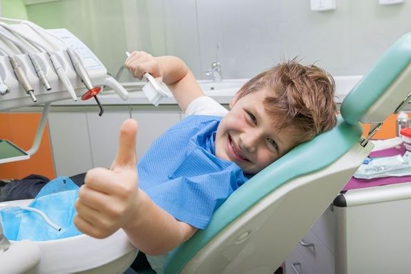 A child in a dentist's chair representing the young patients of general dentistry provider Byrd Adkins D.D.S. Smile Company in Amarillo, TX