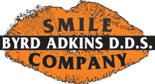 Orange and gray logo of dental services provider Byrd Adkins D.D.S. Smile Company in Amarillo, TX